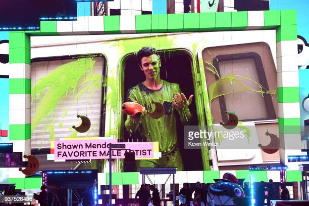 Shawn Mendes accepts the Favorite Male Artist award offsite for Nickelodeon's 2018 Kids' Choice Awards at The Forum on March 24 2018 in Inglewood...