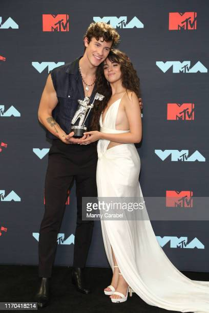 Shawn Mendes and Camila Cabello Best Collaboration Winner pose in the Press Room during the 2019 MTV Video Music Awards at Prudential Center on...