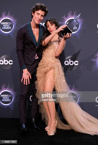 Shawn Mendes and Camila Cabello pose in the press room at the 2019 American Music Awards at Microsoft Theater on November 24 2019 in Los Angeles...