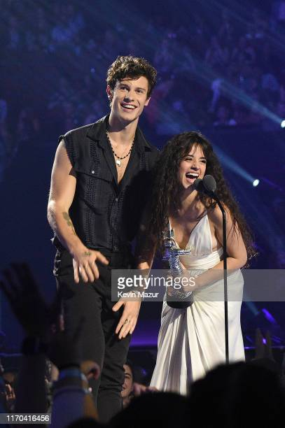 Shawn Mendes and Camila Cabello receive 'Best Collaboration' award onstage during the 2019 MTV Video Music Awards at Prudential Center on August 26...