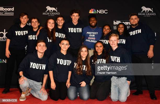 Shawn Mendes and Khalid pose with Marjory Stoneman Douglas Student Choir in the press room during the 2018 Billboard Music Awards at MGM Grand Garden...
