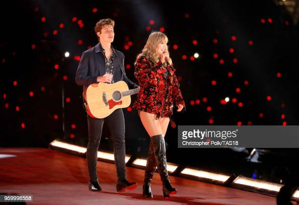 Shawn Mendes and Taylor Swift perform onstage during the Taylor Swift reputation Stadium Tour at the Rose Bowl on May 18 2018 in Pasadena California