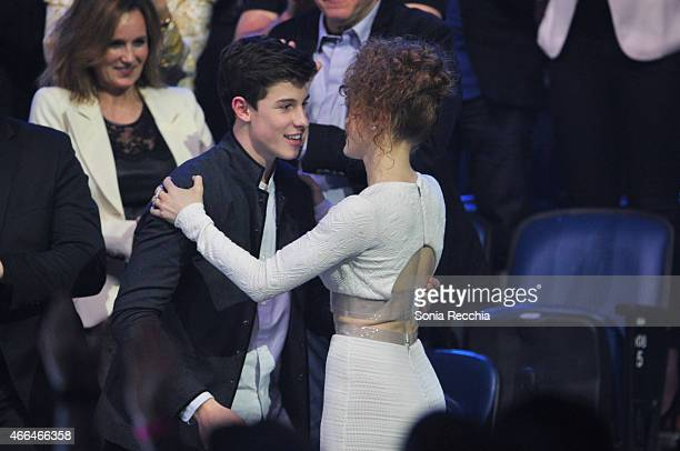Shawn Mendes hugs Kiesza for winning an award at the 2015 JUNO Awards at the FirstOntario Centre on March 15 2015 in Hamilton Canada