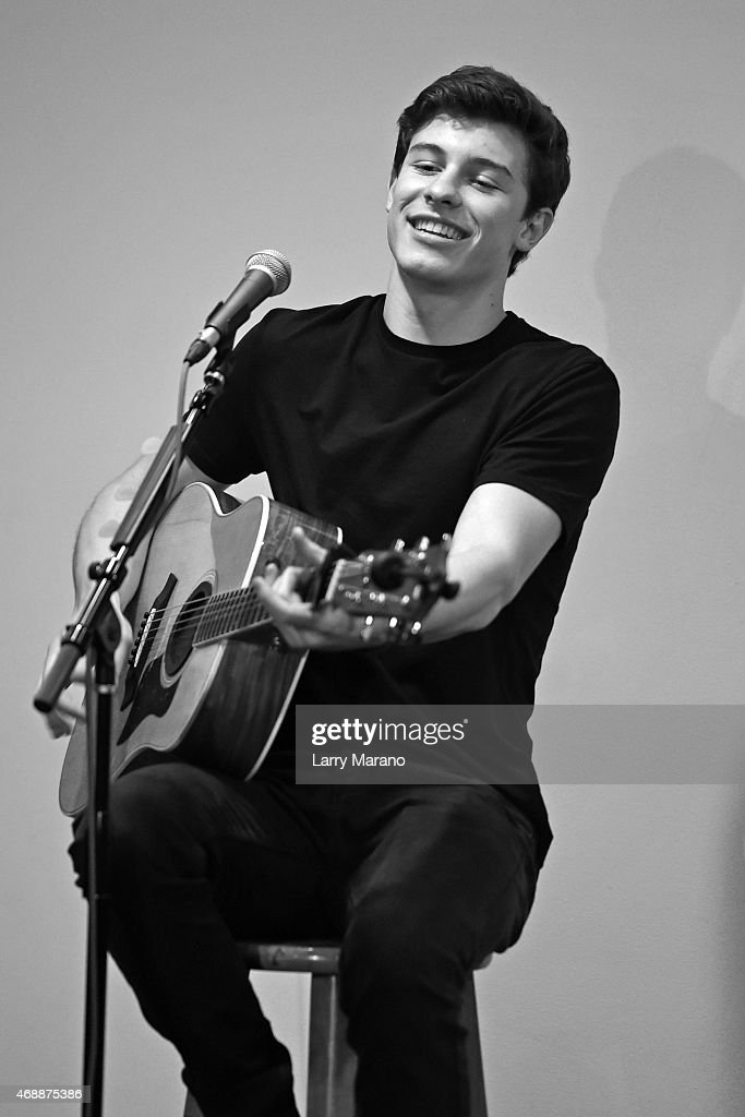 Image has been converted to black and white.) Shawn Mendes performs at Y-100 radio station on April 7, 2015 in Miami, Florida.