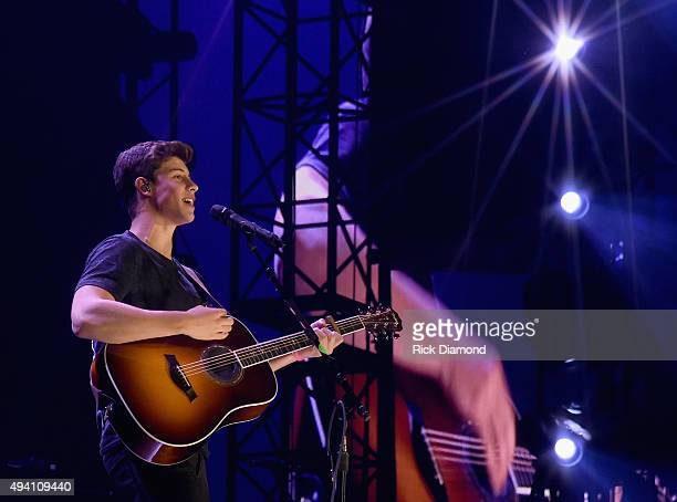 Shawn Mendes performs during Taylor Swift's The 1989 World tour at the Sold Out Georgia Dome on October 24 2015 in Atlanta Georgia
