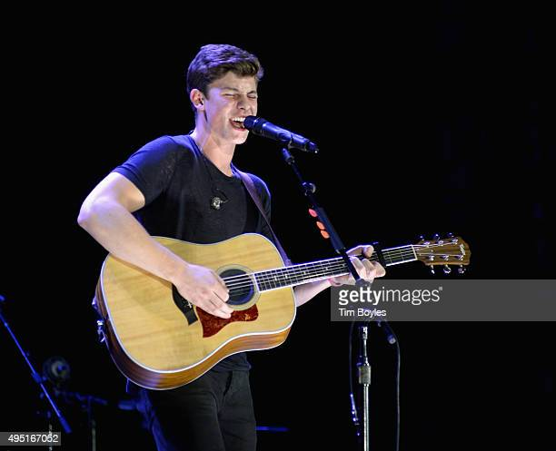 Shawn Mendes performs on Taylor Swift's 'The 1989 World Tour' at Raymond James Stadium on October 31 2015 in Tampa Florida