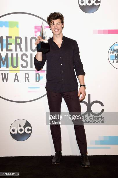 Shawn Mendes poses in the press room during 2017 American Music Awards at Microsoft Theater on November 19 2017 in Los Angeles California