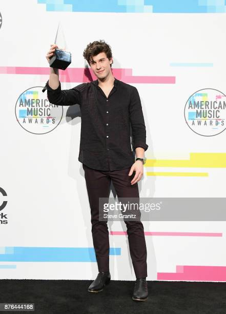 Shawn Mendes poses in the press room during the 2017 American Music Awards at Microsoft Theater on November 19 2017 in Los Angeles California