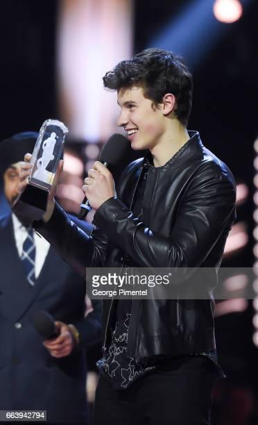 Shawn Mendes receives award at 2017 Juno Awards at Canadian Tire Centre on April 2 2017 in Ottawa Canada