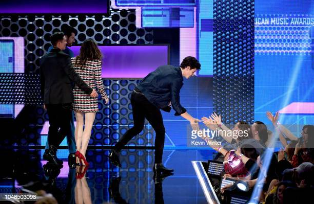 Shawn Mendes walks offstage after accepting Favorite Artist Adult Contemporary during the 2018 American Music Awards at Microsoft Theater on October...