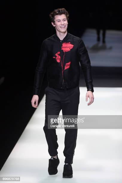 Shawn Mendes walks the runway at the Emporio Armani show during Milan Men's Fashion Week Spring/Summer 2018 on June 17, 2017 in Milan, Italy.