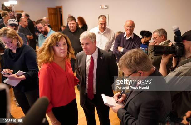 Shawn Moody and his wife Chrissi look at a results screen while talking to reporters on Tuesday November 6 2018 at Moody's Collision Center in Gorham...