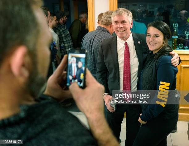 Shawn Moody poses for a photo with supporter Kiara Field of Buxton taken on a phone by her father on Tuesday November 6 2018 at Moody's Collision...