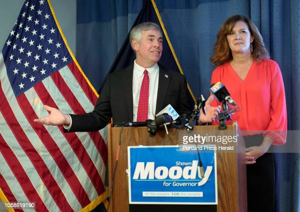Shawn Moody stands with his wife Chrissi while talking to supporters and conceding the gubernatorial race to Janet Mills on Tuesday night in Gorham