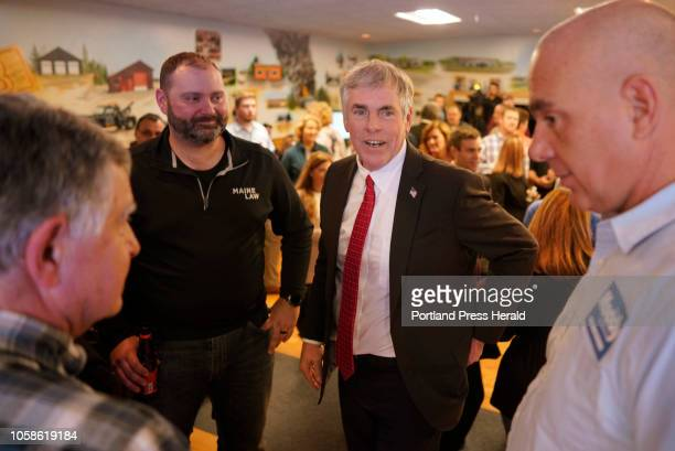 Shawn Moody talks with supporters as election results come in on Tuesday November 6 2018 at Moody's Collision Center in Gorham the headquarters for...