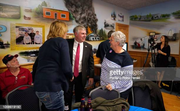 Shawn Moody talks with supporters Jennifer Connors left and Jane Dube on Tuesday November 6 2018 at Moody's Collision Center in Gorham the...
