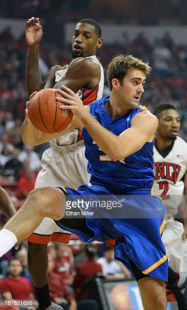Shawn Moore of the UC Santa Barbara Gauchos grabs a rebound in front of Roscoe Smith of the UNLV Rebels during their game at the Thomas Mack Center...