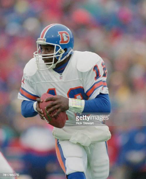 Shawn Moore Quarterback for the Denver Broncos runs the ball during the American Football Conference game against the Buffalo Bills on 12 December...