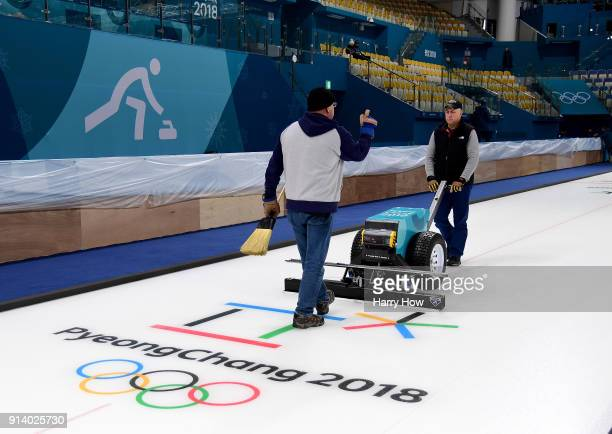 Shawn Olesen and Eric Montford prepare the ice at the Gangneung Curling Centre ahead of the PyeongChang 2018 Winter Olympics on February 4 2018 in...