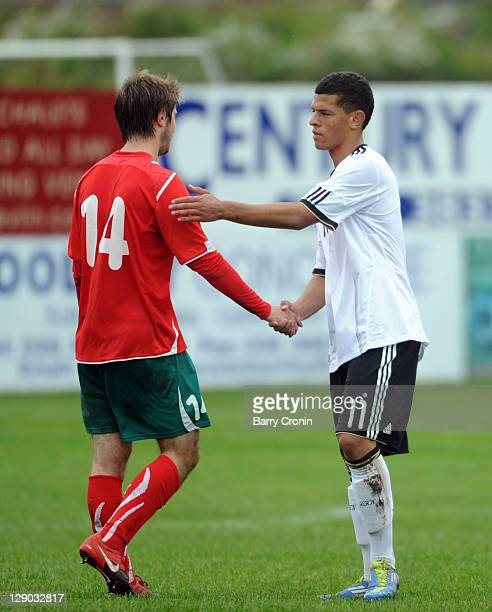 Shawn Parker of Germany and Yury Valovik of Belarus shake hands after the UEFA EURO U19 Qualifier match between Germany and Belarus on October 11...