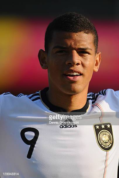 Shawn Parker of Germany sings the national anthem prior to the U19 International friendly match between Belgium and Germany at Stade Bielmont on...
