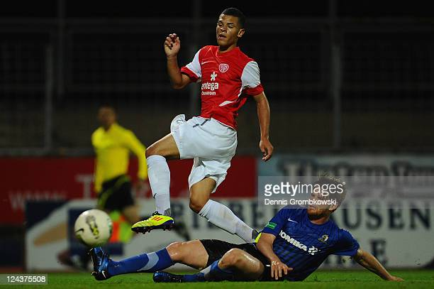 Shawn Parker of Mainz is challenged by Denny Herzig of Trier during the Regionalliga West match between SV Eintracht Trier 05 and FSV Mainz 05 II at...