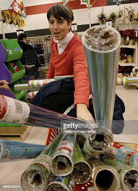 Shawn Patrick Ouellette/Staff Photographer Ellen Webber of Durham NH fills her cart with wrapping paper for next Christmas at Michaels in Scarborough...