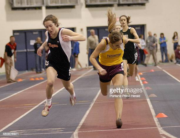Shawn Patrick Ouellette/Staff Photographer Hannah Wiley of Thornton Academy leans toward the finish line and captures the title in the 400meter run