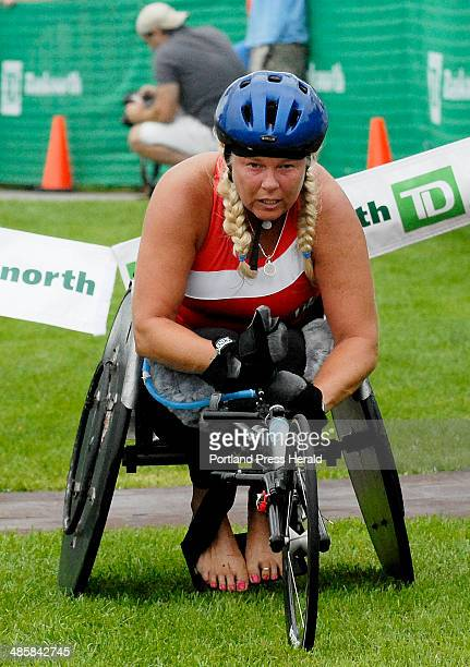 Shawn Patrick Ouellette/Staff Photographer Jacqui Kapinowski the winner of the women's wheelchair division got stuck in the grass on a hill near the...