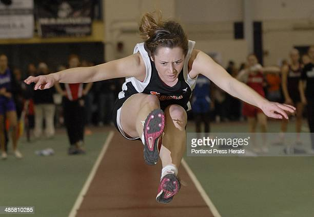 Shawn Patrick Ouellette/Staff Photographer Maria Curit of Biddeford set a state record of 17 feet 61/2 inches in the girls' long jump Monday at the...