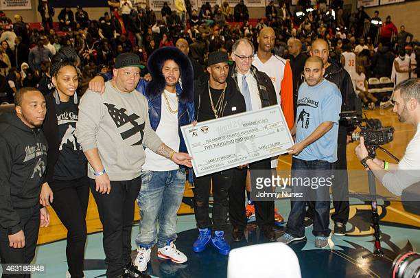 Shawn 'Pecas' Costner , Fat Joe , Victor Cruz , John Wallace , and John Starks participate in a donation ceremony during the 2015 Celebrity All Star...