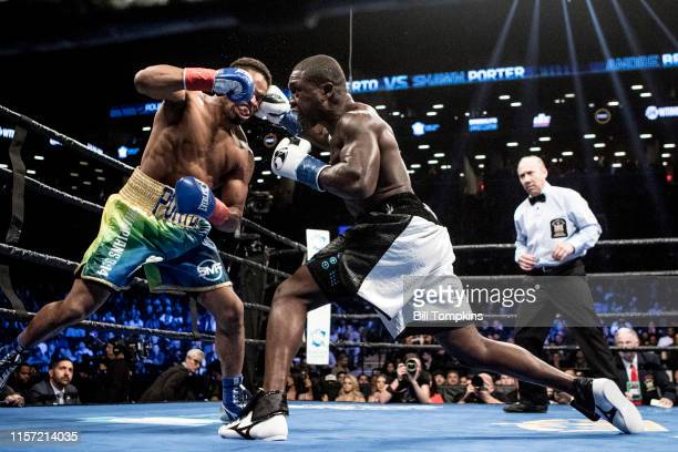 Shawn Porter and Andre Berto throw simutaneous punches in a fight that Porter wins by TKO in the 9th round of their WBC welterweight title eliminator...