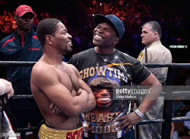 Shawn Porter and his father and trainer Kenneth Porter wait for the judge's decision after a welterweight fight against Adrien Broner at MGM Grand...