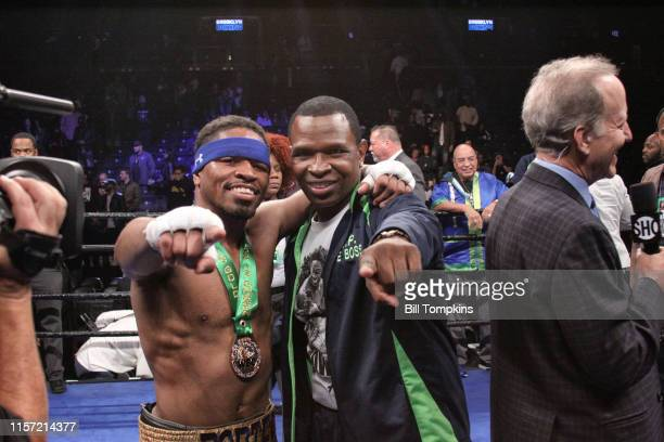 Shawn Porter and Kenny Porter posing after Porter defeats Andre Berto by TKO in the 9th round of their WBC welterweight title eliminator at the...