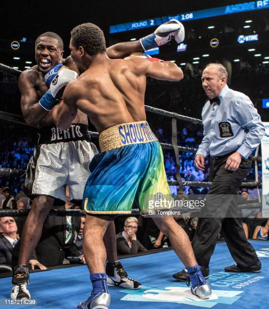 Shawn Porter battles Andre Berto in the corner Porter wins by TKO in the 9th round of their WBC welterweight title eliminator at the Barclay Center...