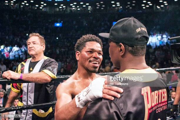Shawn Porter embraces his father Kenny when its announced that he has lost to Keith Thurman by Unanimous Decsion in their WBA Welterweight title...
