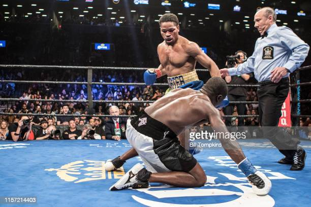 Shawn Porter knocks Andre Berto down and wins by TKO in the 9th round of their WBC welterweight title eliminator at the Barclay Center April 22 2017...