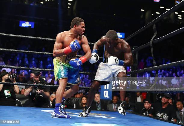 Shawn Porter knocks down Andre Berto in the ninth round during their WBC welterweight eliminator bout at the Barclays Center on April 22 2017 in New...
