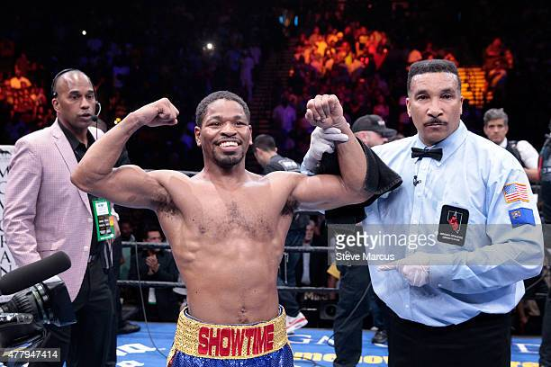 Shawn Porter poses with referee Tony Weeks after beating Adrien Broner in a welterweight fight at MGM Grand Garden Arena on June 20 2015 in Las Vegas...
