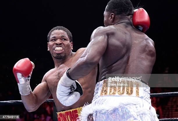 Shawn Porter punches Adrien Broner during their welterweight bout at MGM Grand Garden Arena on June 20 2015 in Las Vegas Nevada Porter won the fight...
