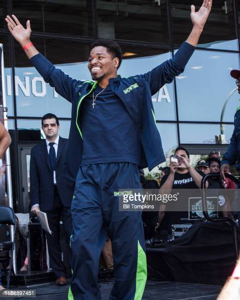Shawn Porter raises his arms at the weighin with Keith Thurman prior to their WBA Welterweight title fight at The Barclay Center on June 24, 2016 in...