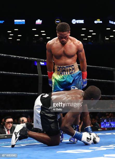 Shawn Porter stands over Andre Berto which was ruled a slip during their WBC welterweight eliminator bout at the Barclays Center on April 22 2017 in...