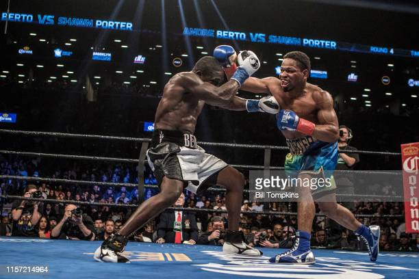 Shawn Porter throws a right punch and defeats Andre Berto by TKO in the 9th round of their WBC welterweight title eliminator at the Barclay Center...
