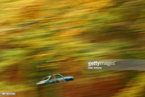 Shawn Rayner of Great Britain drives with codriver Declan Dear of Great Britain during day three of the FIA World Rally Championship Great Britain on...