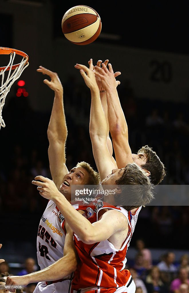 Shawn Redhage and Greg Hire of the Wildcats and Daniel Jackson of the Hawks contest possession during game two of the NBL Semi Final series between the Wollongong Hawks and the Perth Wildcats at WIN Entertainment Centre on March 31, 2013 in Wollongong, Australia.