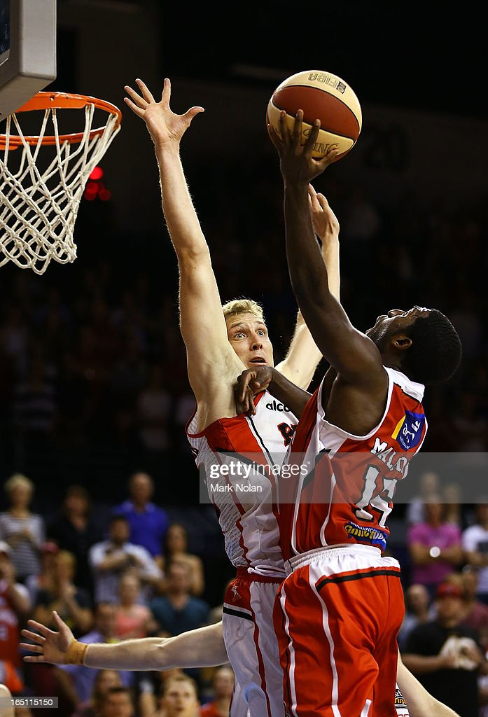 Shawn Redhage of the Wildcats blocks Malcolm Grant of the Hawks during game two of the NBL Semi Final series between the Wollongong Hawks and the Perth Wildcats at WIN Entertainment Centre on March 31, 2013 in Wollongong, Australia.