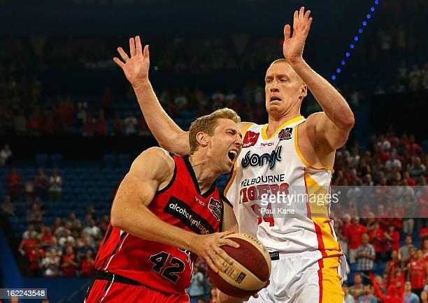 Shawn Redhage of the Wildcats drives to the basket against Adam Ballinger of the Tigers during the round 20 NBL match between the Perth Wildcats and...