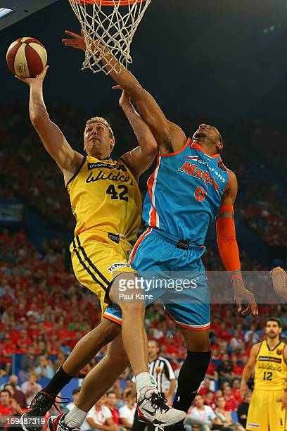 Shawn Redhage of the Wildcats drives to the basket against Shane Edwards of the Taipans during the round 15 NBL match between the Perth Wildcats and...