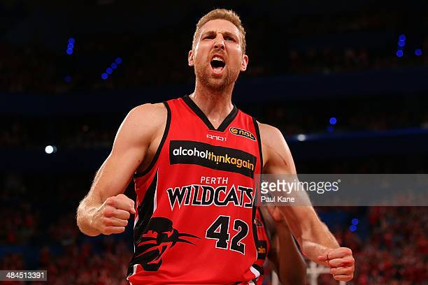 Shawn Redhage of the Wildcats fires up the spectators during game three of the NBL Grand Final series between the Perth Wildcats and the Adelaide...