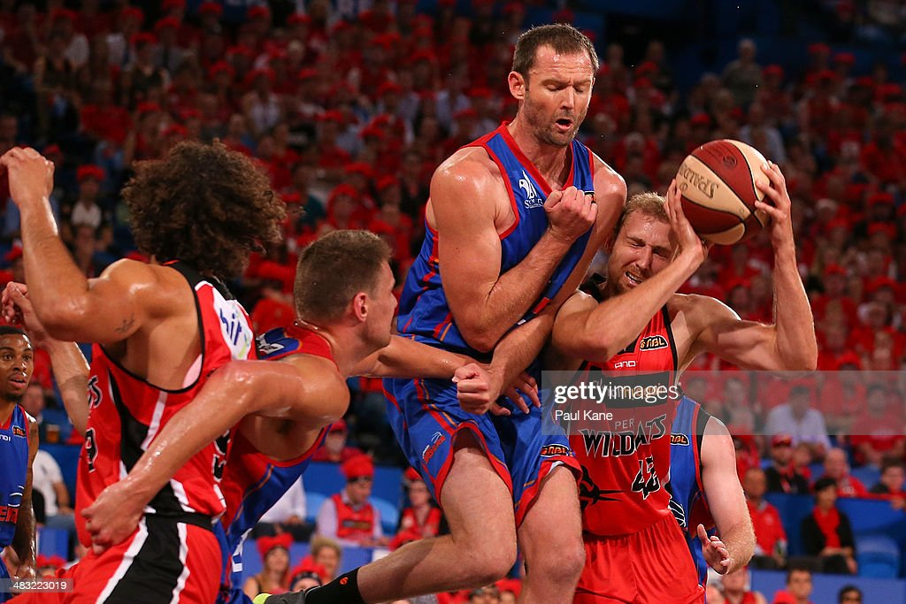 Shawn Redhage of the Wildcats gets fouled by Anthony Petrie of the 36ers during game one of the NBL Grand Final series between the Perth Wildcats and the Adelaide 36ers at Perth Arena on April 7, 2014 in Perth, Australia.